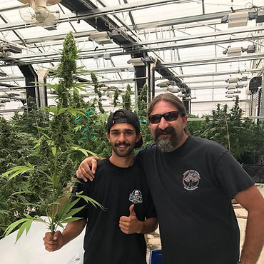 Crockett and his son Brian working side by side in one of their many gardens.