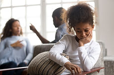 Upset African American girl sitting alon