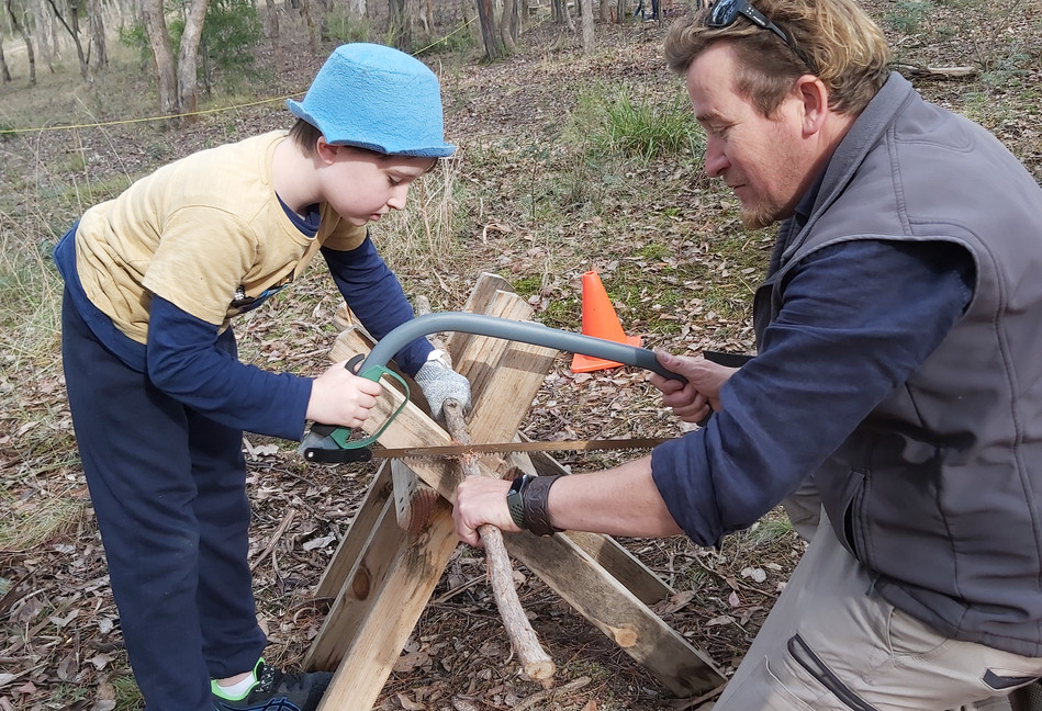 Cutting branches for the children's huts