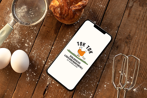 iphone-xs-max-mockup-over-a-wooden-surface-surrounded-by-baking-supplies-25491.png