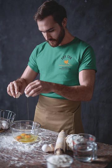 baker-wearing-a-tshirt-mockup-breaking-eggs-a20269 (1)_edited.png