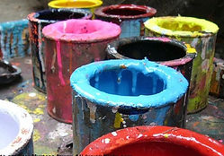 multi colored paints in buckets