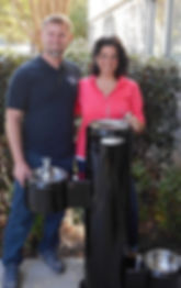 couple standing beside a commercial dog drinking fountain