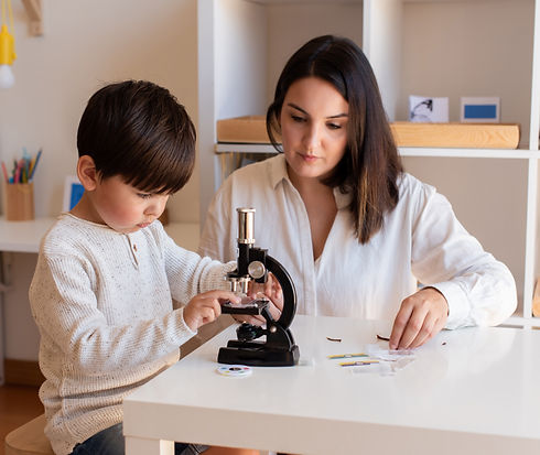 Lillte%20Kid%20exploring%20science%20with%20a%20microscope%20and%20mother%20or%20teacher%20help.%20H