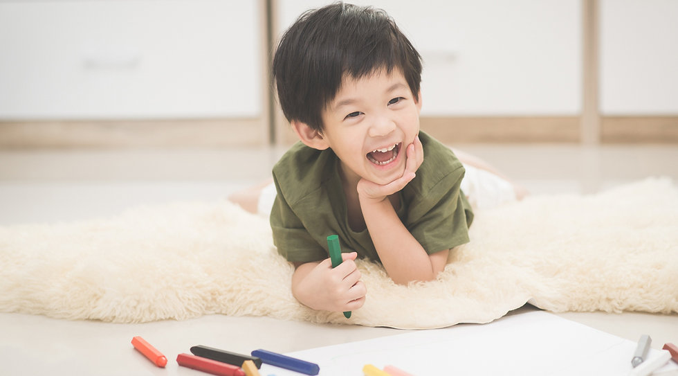 Cute%20Asian%20child%20drawing%20picture%20with%20crayon_edited.jpg