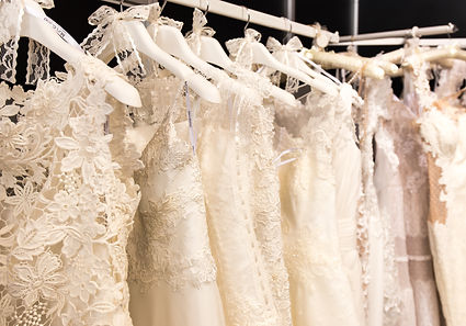wedding dresses hanging on racks.jpg