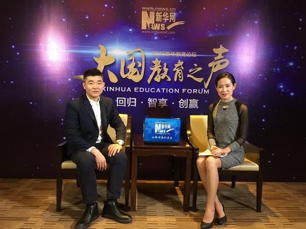 SNA teacher - Sui Xiaoyu - giving an interview to xinhuanet.com
