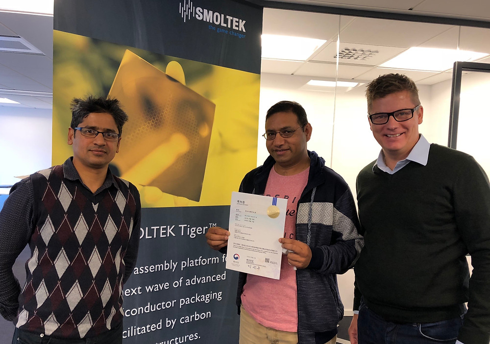 Dr. Shafiq Kabir, Amin Saleem and Ola Tiverman show off the new South Korean patent cetificate