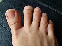 bare foot, asian woman foot on black woo