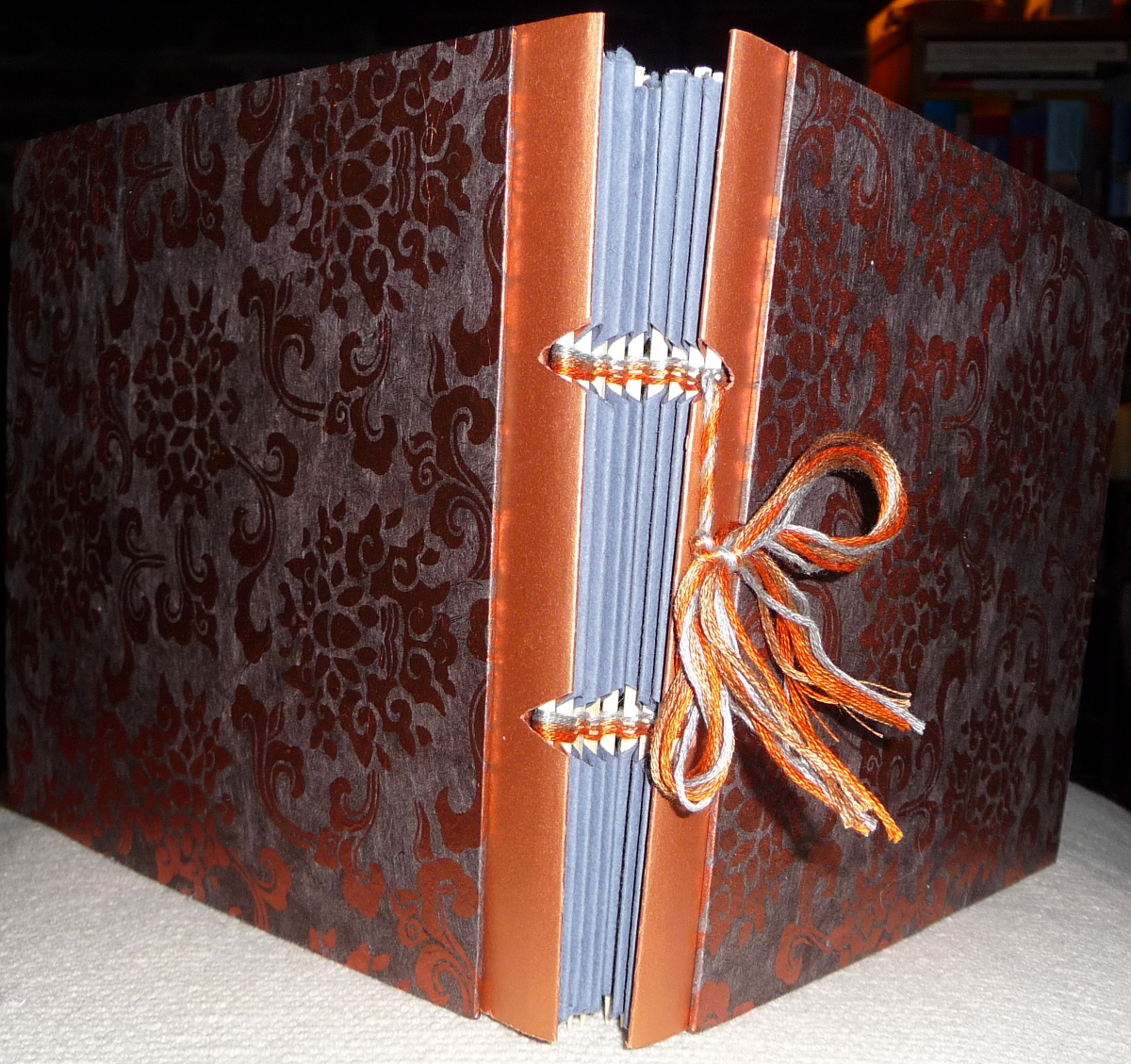 Stick-bound gift album