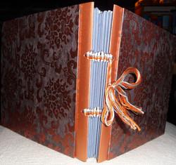 Stick-bound gift album