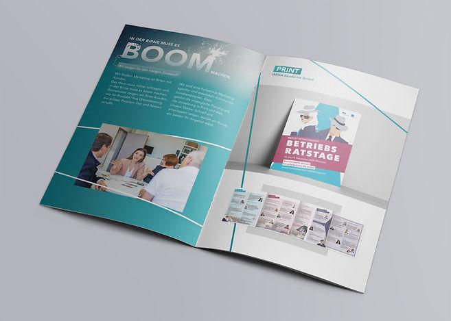 Charismarcom-Brochure-MockUp-Innen.jpg