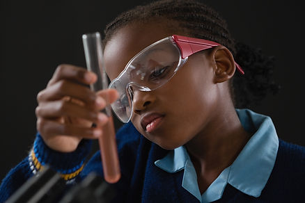 schoolgirl-doing-a-chemical-experiment-a