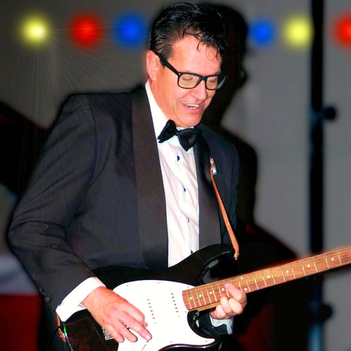 Brent Freeman as Buddy Holly