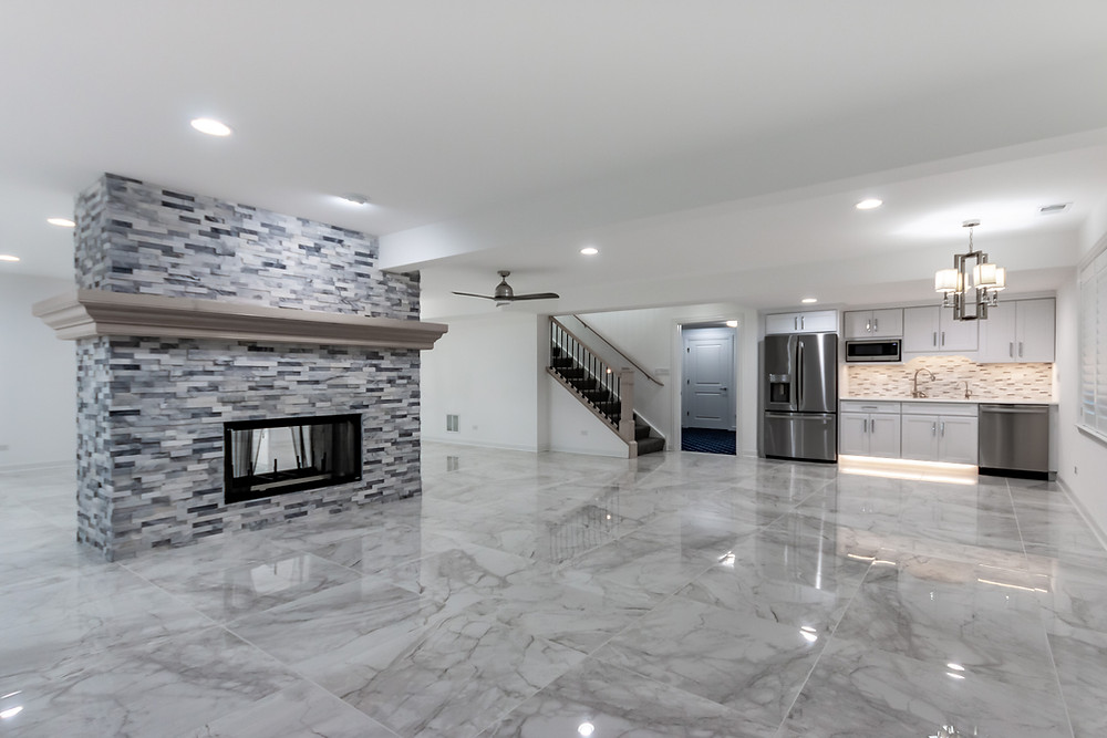 basement stone fireplace and marble floors
