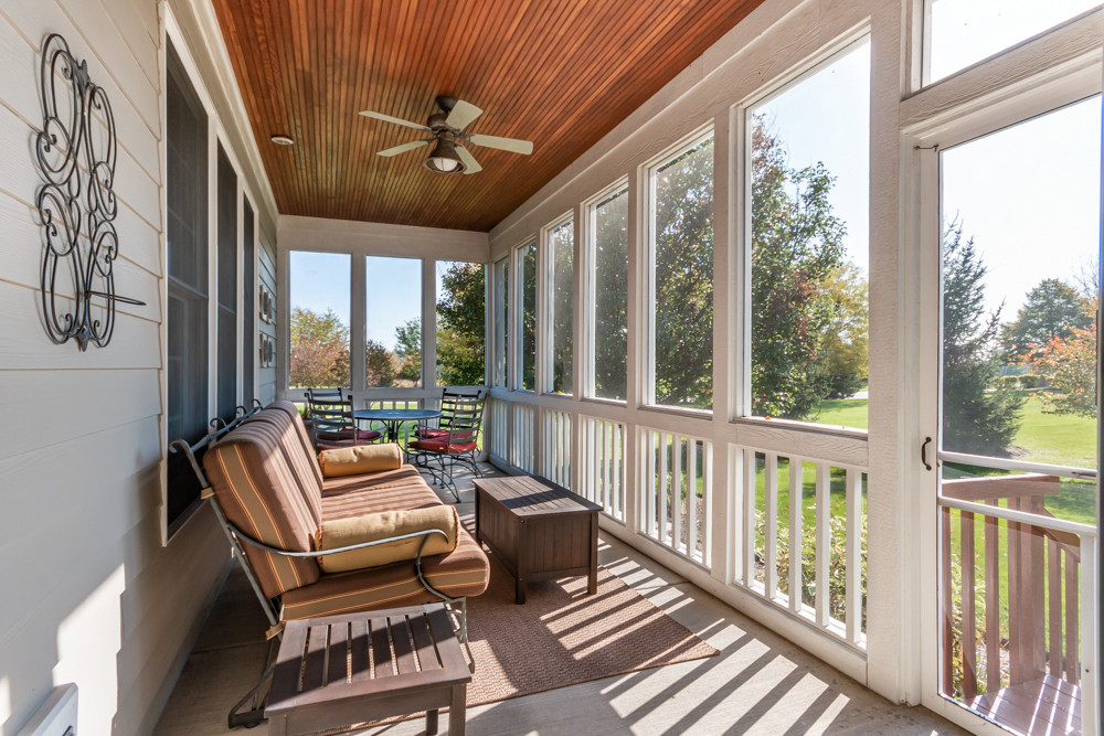 Clean and furnished screened in porch to help your home sell fast