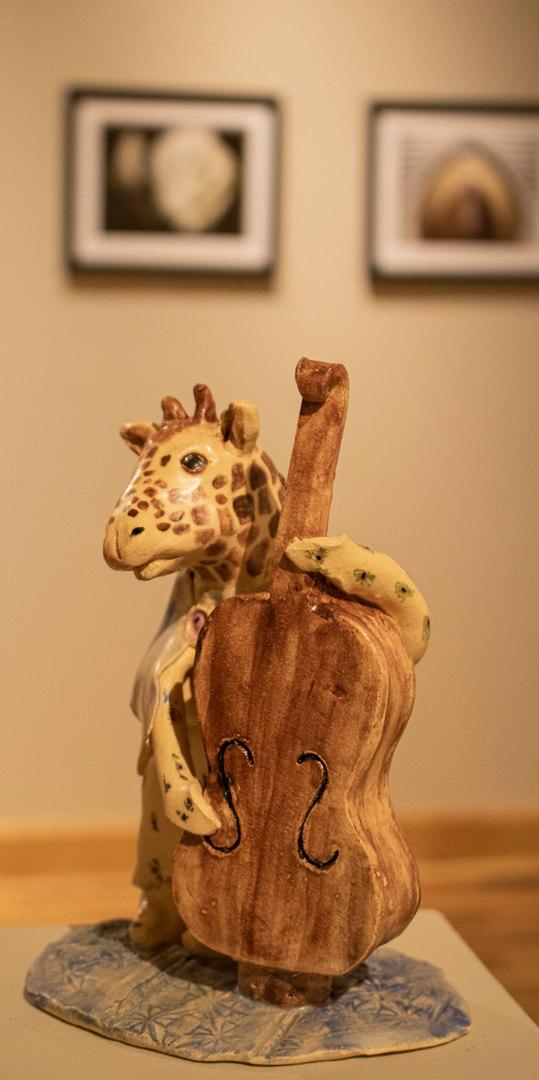 Giraffe on Bass by Debby Freed