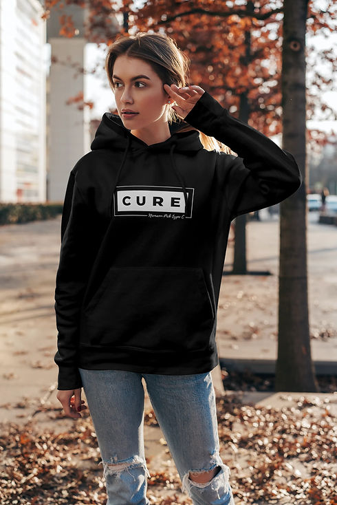 Young Woman wearing an Adult Cure Hoodie