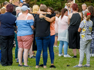Friends' Heartache: Over 100 friends, parents and staff gather at school vigil for slain Alesha MacPhail in tribute to schoolgirl 'who touched us all'