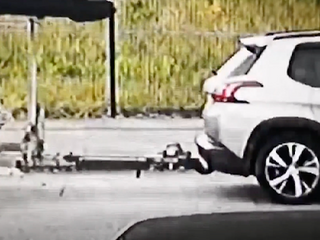 CCTV shows brazen thief cut chain on jet ski trailer outside Scots home and clip onto own car
