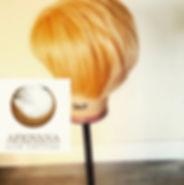 cut andstyled short blonde wig