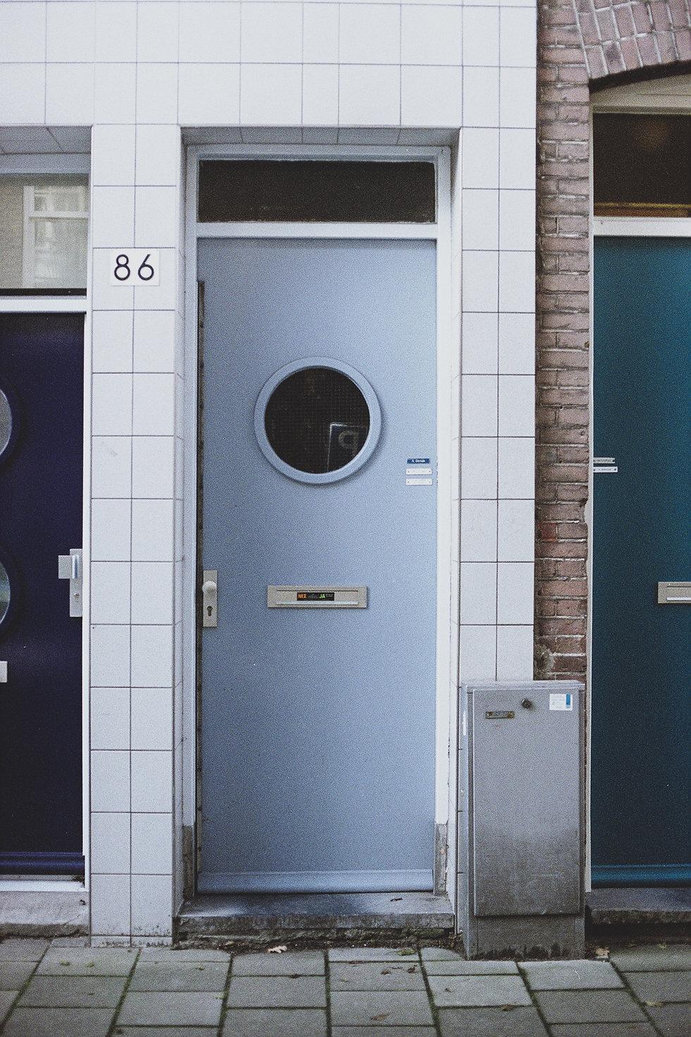 An entrance door of an urban apartment building