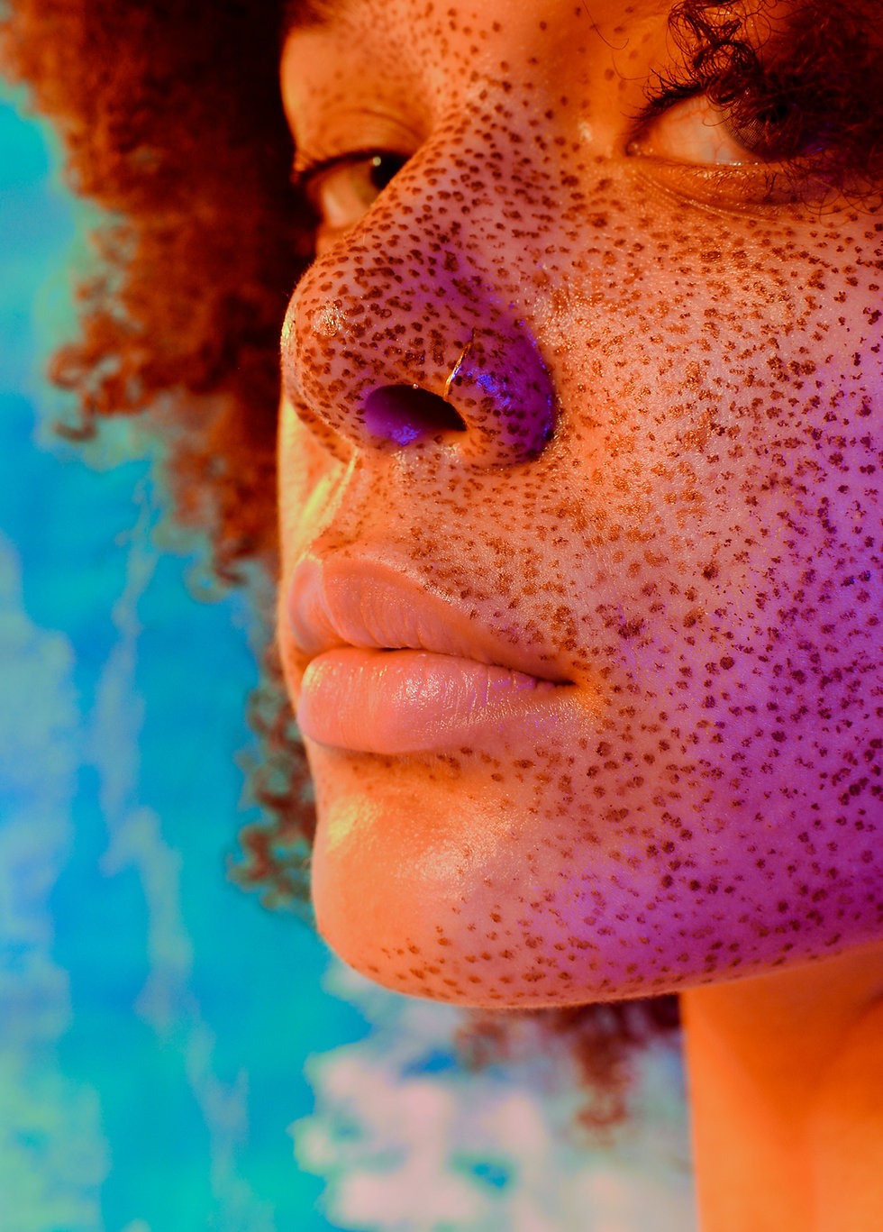 Portrait of a freckled woman
