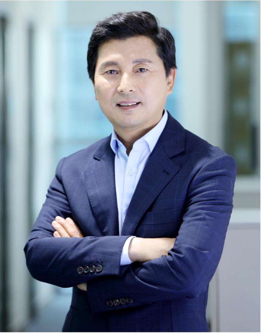 Dr. Il-ung Kim in a suit looking at the camera in an urban outdoors