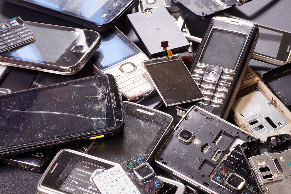 Pile of phones in the garbage