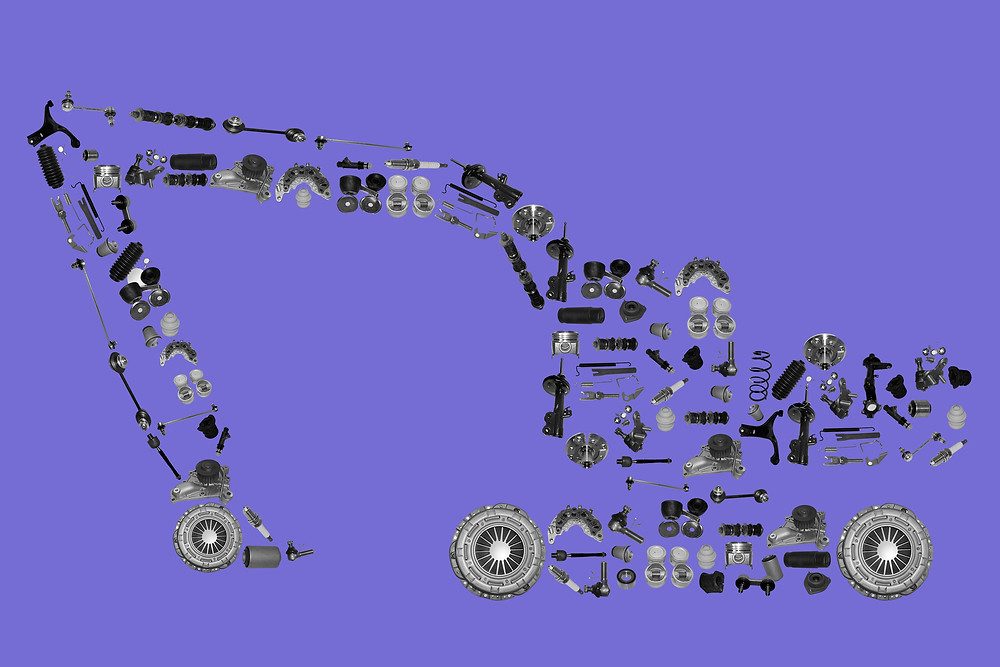Tractor spare parts laid out in a tractors outline