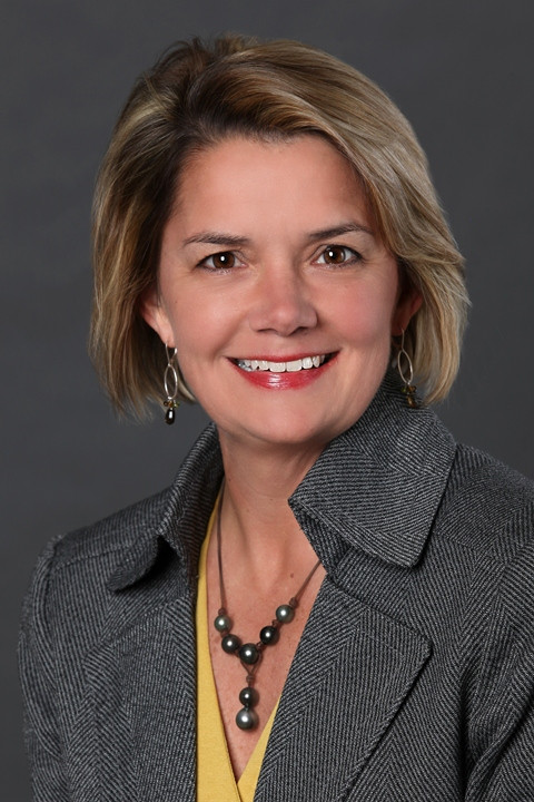 A formal face shot of Ms. Teresa Ostapower in a grey jacket