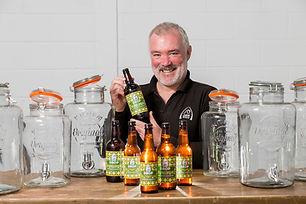 Mark Hazell with bottles of Drop.jpg