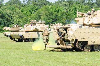 M1A2 Bradley Discharging Fire Team