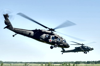 UH-60 Departing LZ w/ AH-6 Cover