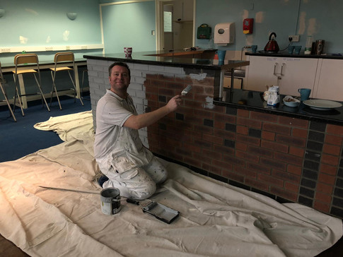 Sam Garland Painting the Hub's Cafe Bar