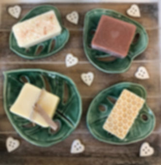A range of natural soaps on handmade porcelain soap dishes