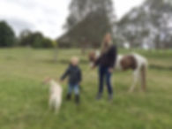 Nadia Schoner with her son, her dog Rosie and Pony Flossy