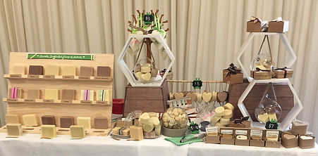 Soap display in wooden stand and glass bowls