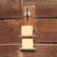 Soaps in industrial holder on wooden stable door