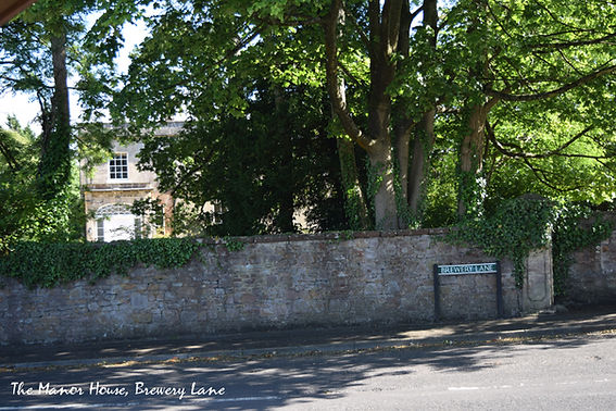 Photo of the Manor House taken from the cross roads where Brewery Lane joins Holcombe Hill