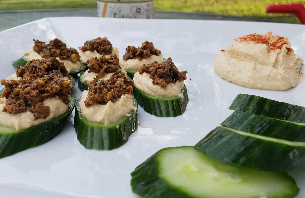 Olive Tapenade on hummus and cucumber
