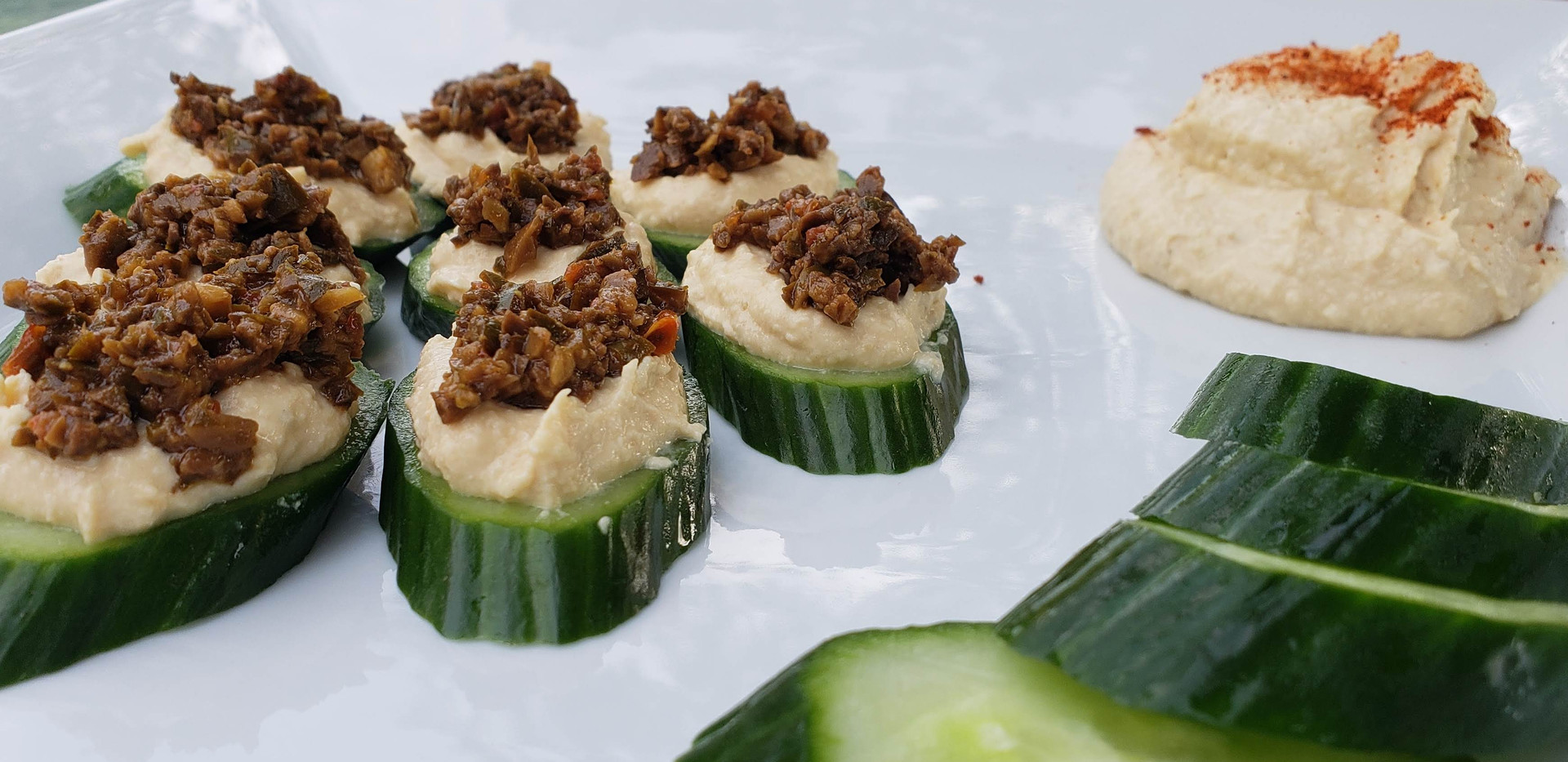 Tapenade on cucumber with hummus.jpg