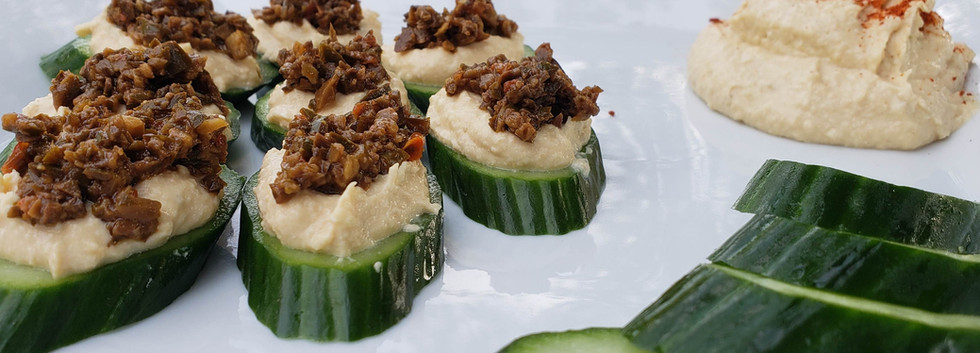 Tapenade on cucumber with hummus.jpg