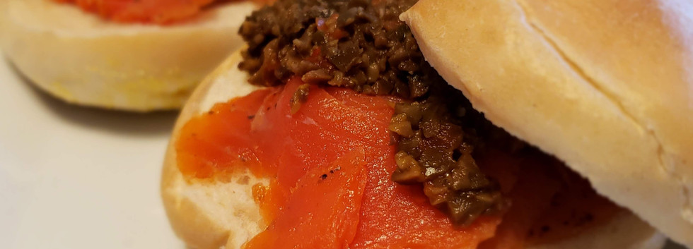 Olive Tapenade on smoked salmon bagel