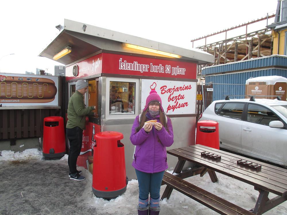 Enjoying the amazing Icelandic hot dog in Reykjavik