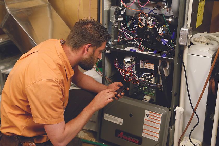 technician-calibrating-furnace80314f7707