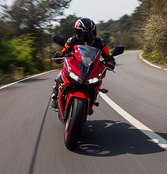 red-motorcycle-driving-on-the-road_edite