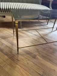 Close up of brass legs on 1940's French Coffee table