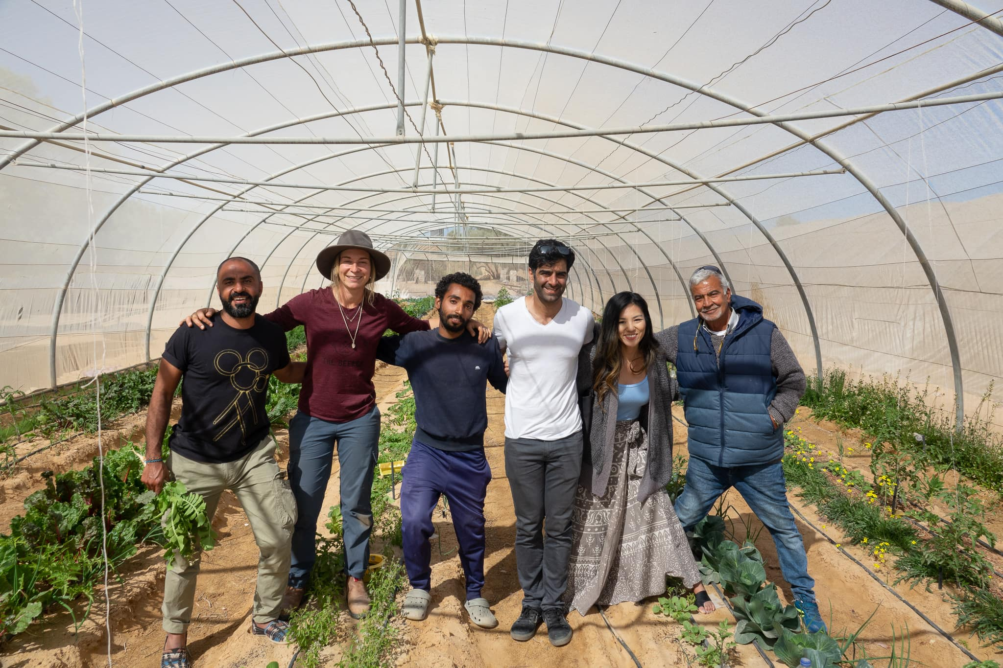 Group in greenhouse
