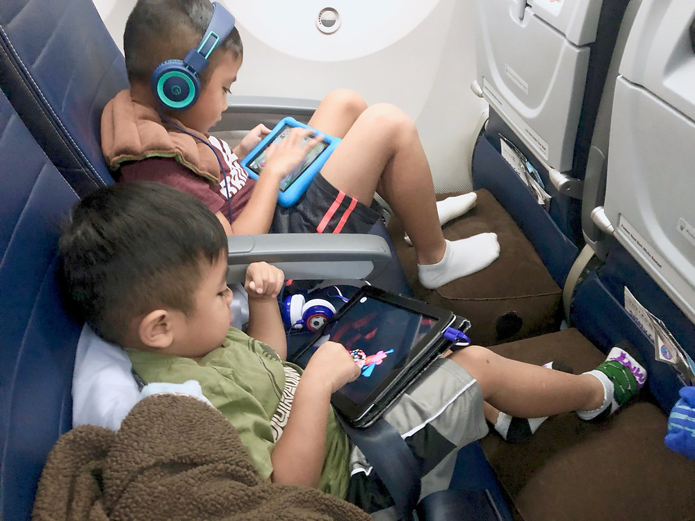 tips for long flights with kids // sunnyinjune.com -- get a plane pal, an inflatable leg rest that the kids can use to prop their feet up or rest their legs!